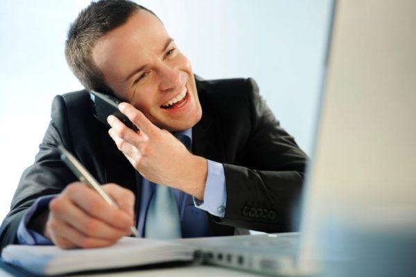 Man on phone selling